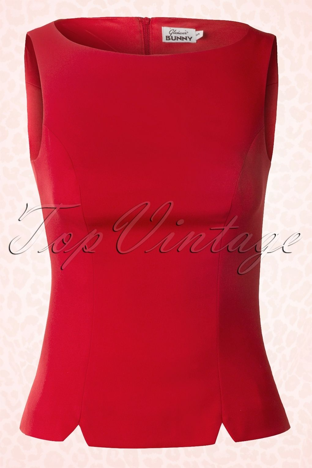 Whether you're going for 50's or 60's clothing, this fabulous50s Shift Top in Redby Glamour Bunnywill give you that desired retro clothing look!Nicely fitted model with flattering vertical darts that run into 2 small slits at the front and back for a slim silhouette, oh la la! Made from a light stretchy cotton blend in elegant red and finished off with a zipper that runs along the entire back of the top. Nice to pair with classic trousers and sassy heels just like Gia Genevi...