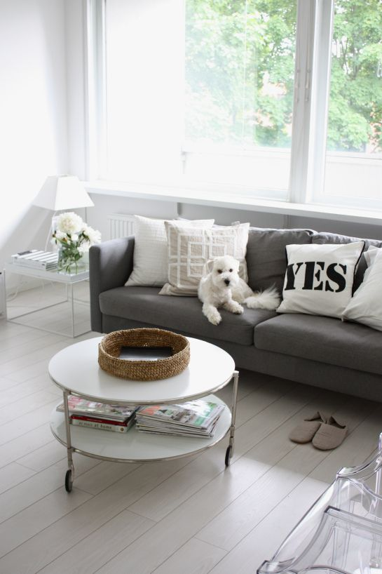 Love this grey couch and round coffee table