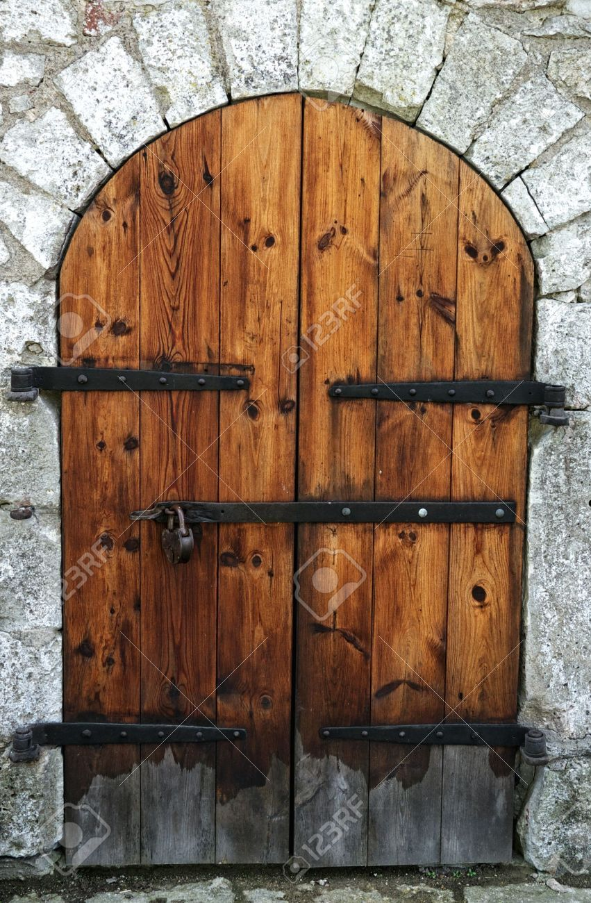 Old Wooden Door In A Stone Wall. Stock Photo, Picture And Royalty ...