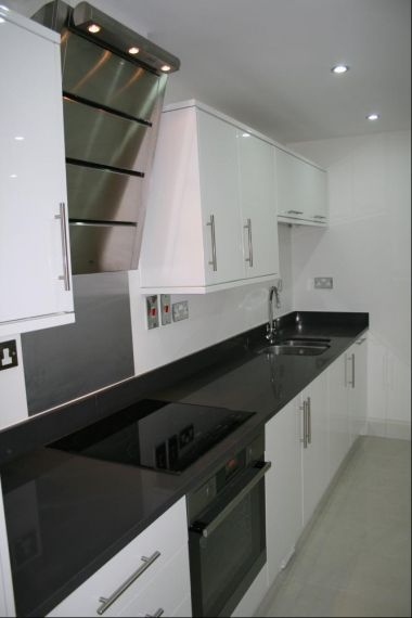 really funky, modern, kitchen induction hob cooker and extractor