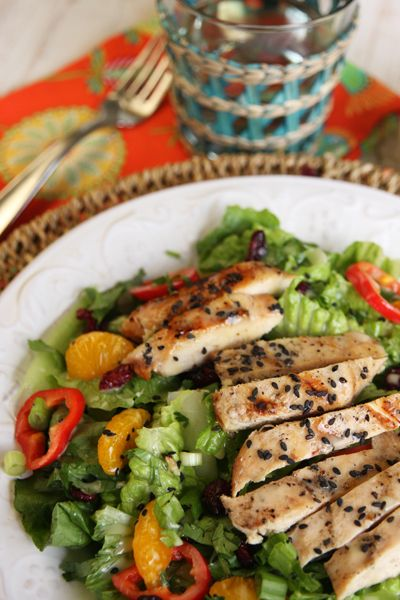 Caribbean Sesame-Chargrilled Chicken Salad with Mandarin Vinaigrette on Chilled Greens