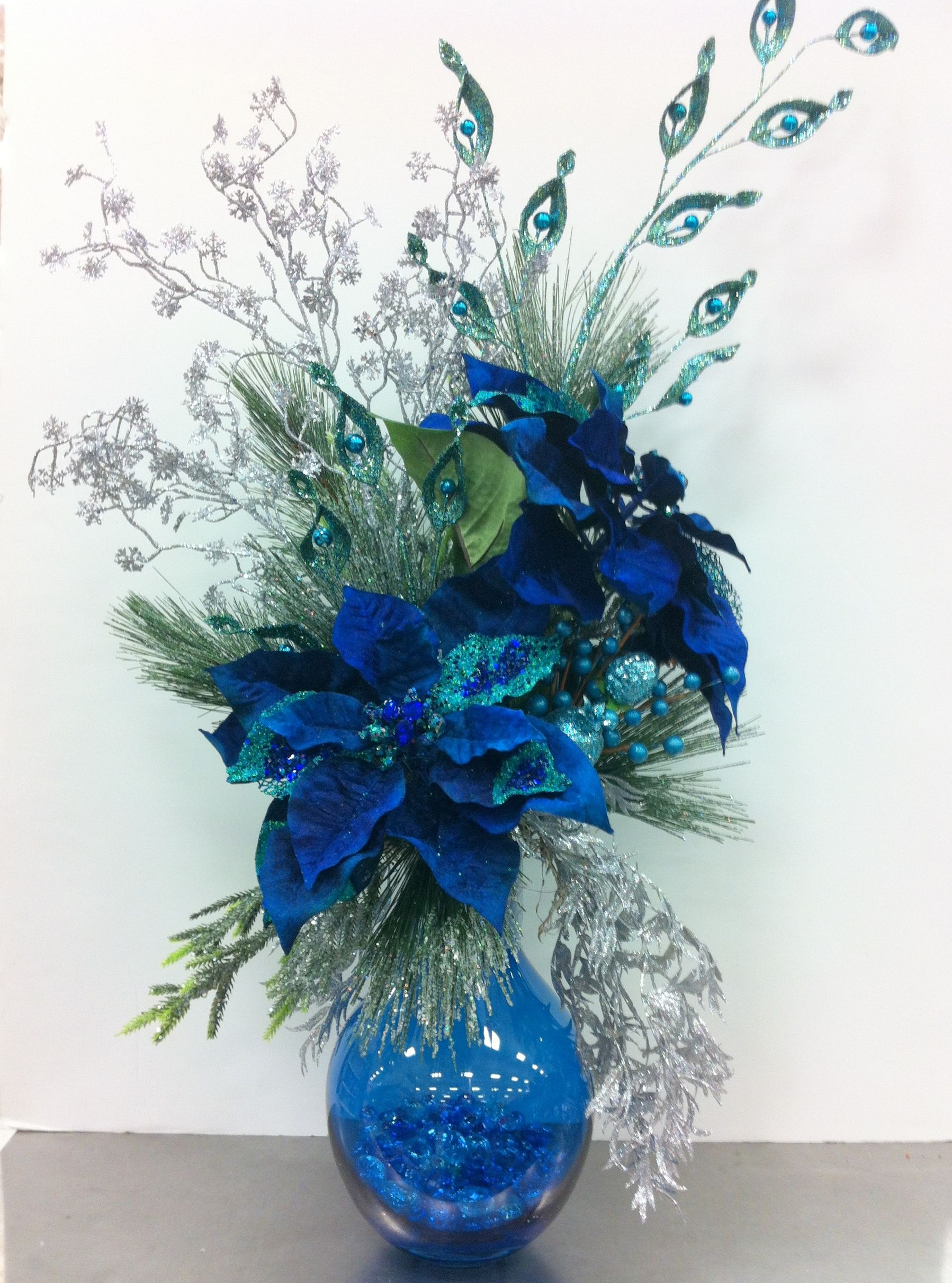 Blue Centerpiece Flowers : This christmas arrangement is in peacock blue