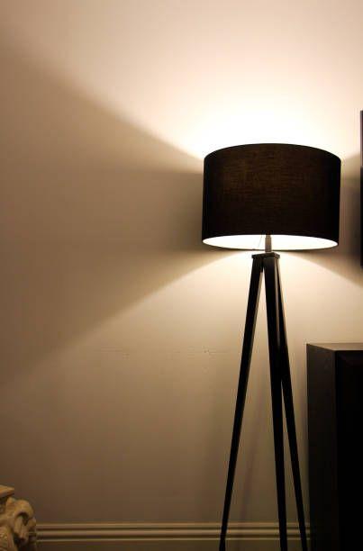 Delightful Illuminated Floor Lamp Against Wall At Home Floor Lamps, Standing Lamps,  Standard Lamps
