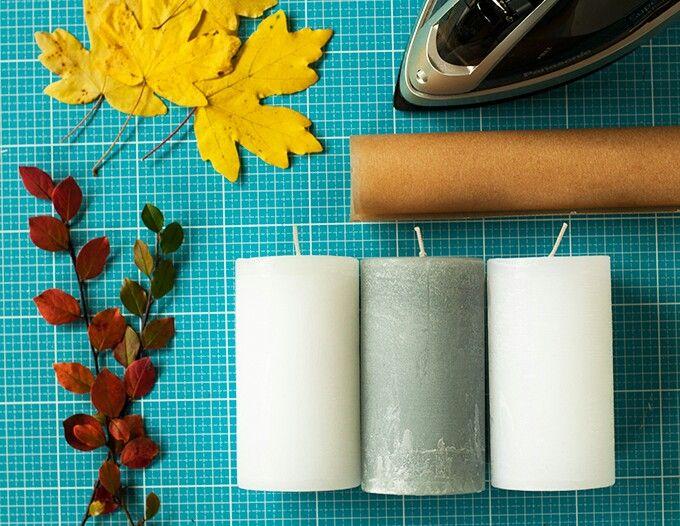 Herbstblätter durch Backpapier auf Kerze bügeln!