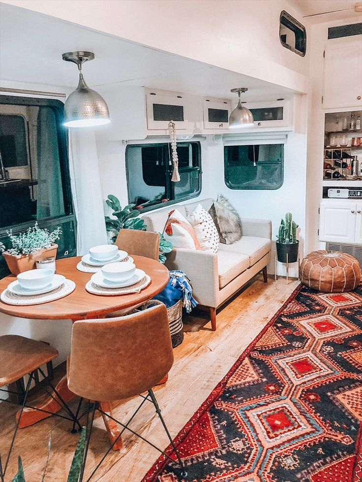 See how a passion for international travel influenced the interior design of this camper renovation from @ems_traveldiary! #rvliving