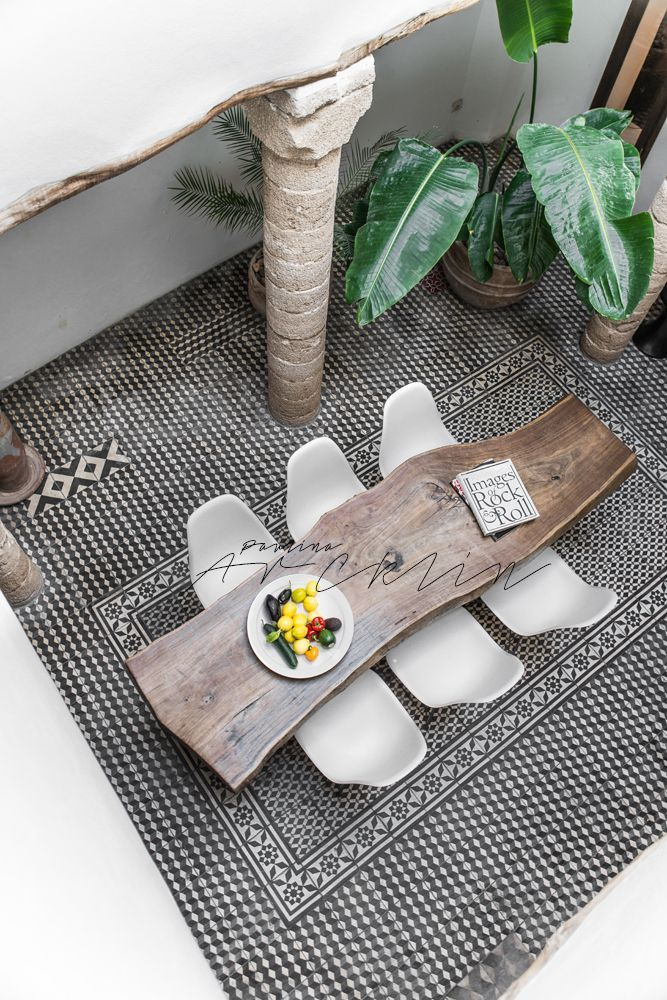 live edge wood dining table in moroccan style tile courtyard