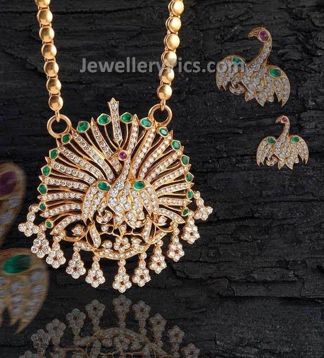 Diamonds studded peacock pendent and ear studs - Latest Jewellery Designs