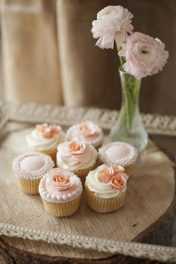 Pretty icing decoration and peach sugar flowers keep things looking feminine and romantic.