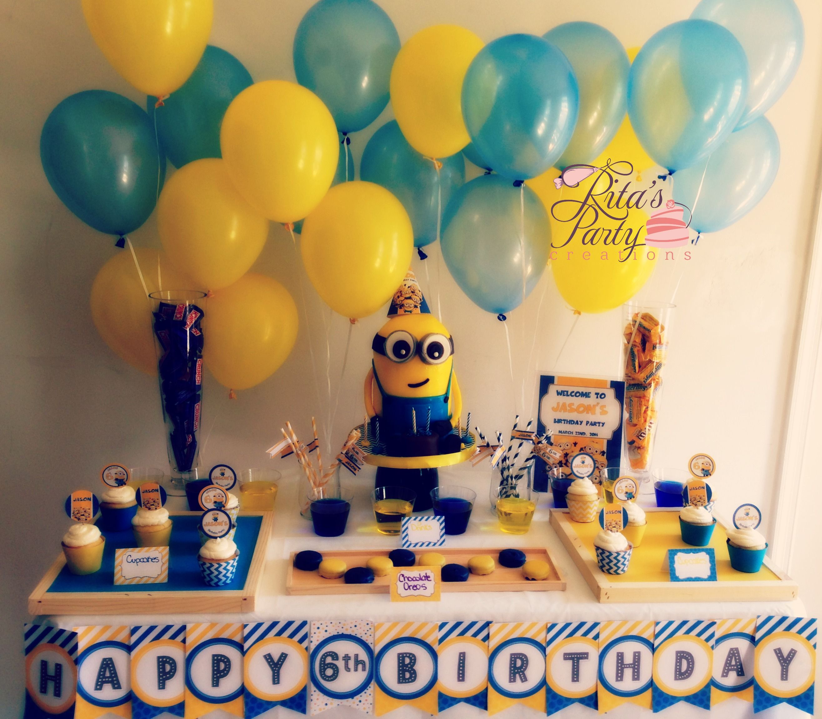 despicable me party table for a 6 year old boy birthday cake in