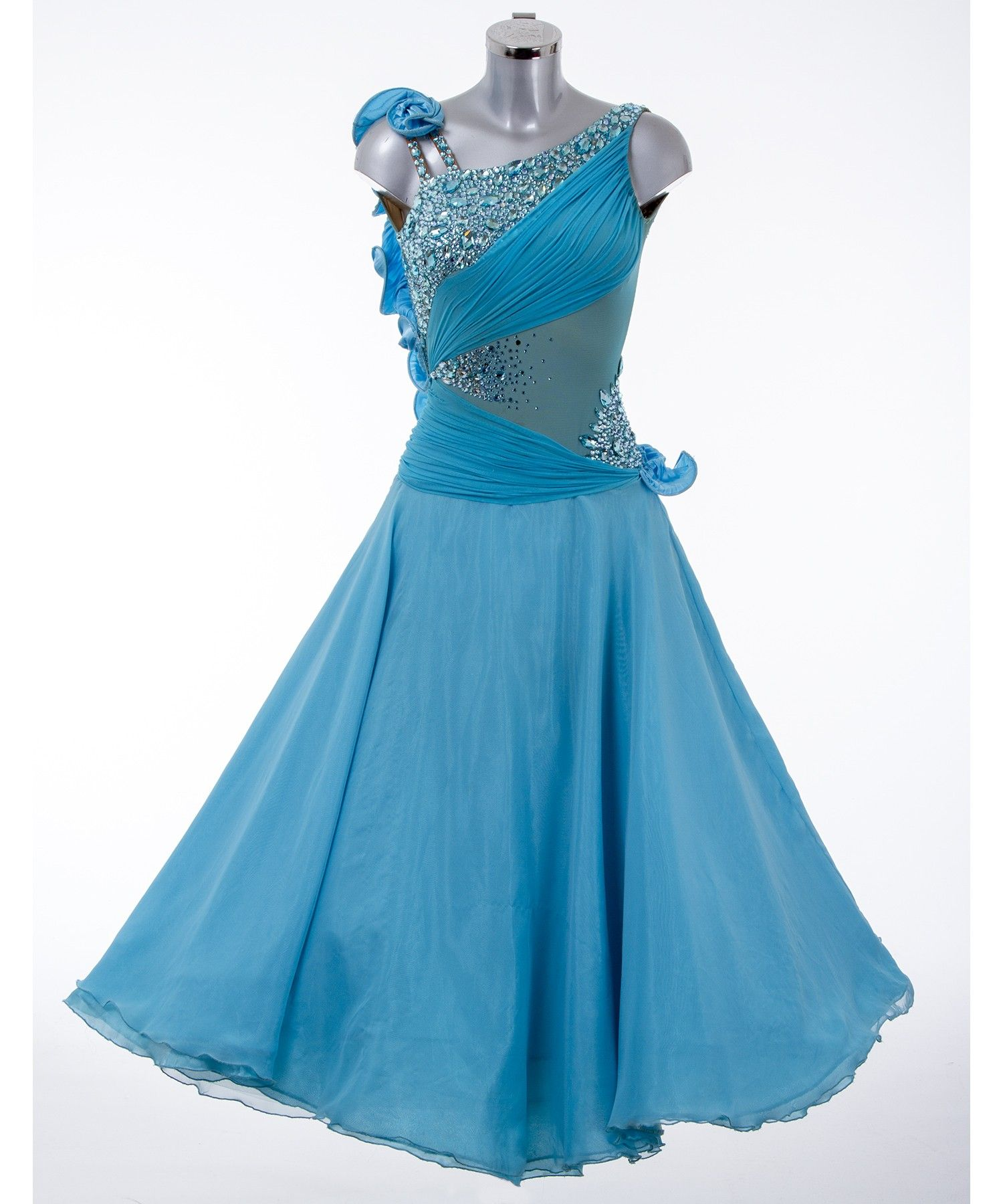 DSI London 354272 Turquoise Ballroom Dress Consisting of Turquoise Mesh, Georgette and Satin. This Ballroom Dress has Aqua Bohimica stones to tone in with the fabrics.
