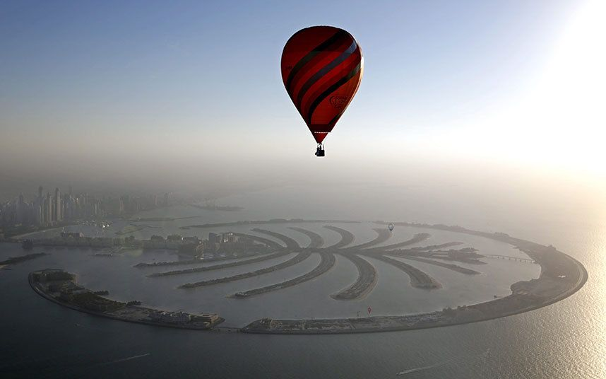 Hot Air Aerostat flies over the man-made Palm island during Dubai International Balloon Fiesta as part of the last day of Dubai Air Games 2015 in Gulf emirate of Dubai, UAE