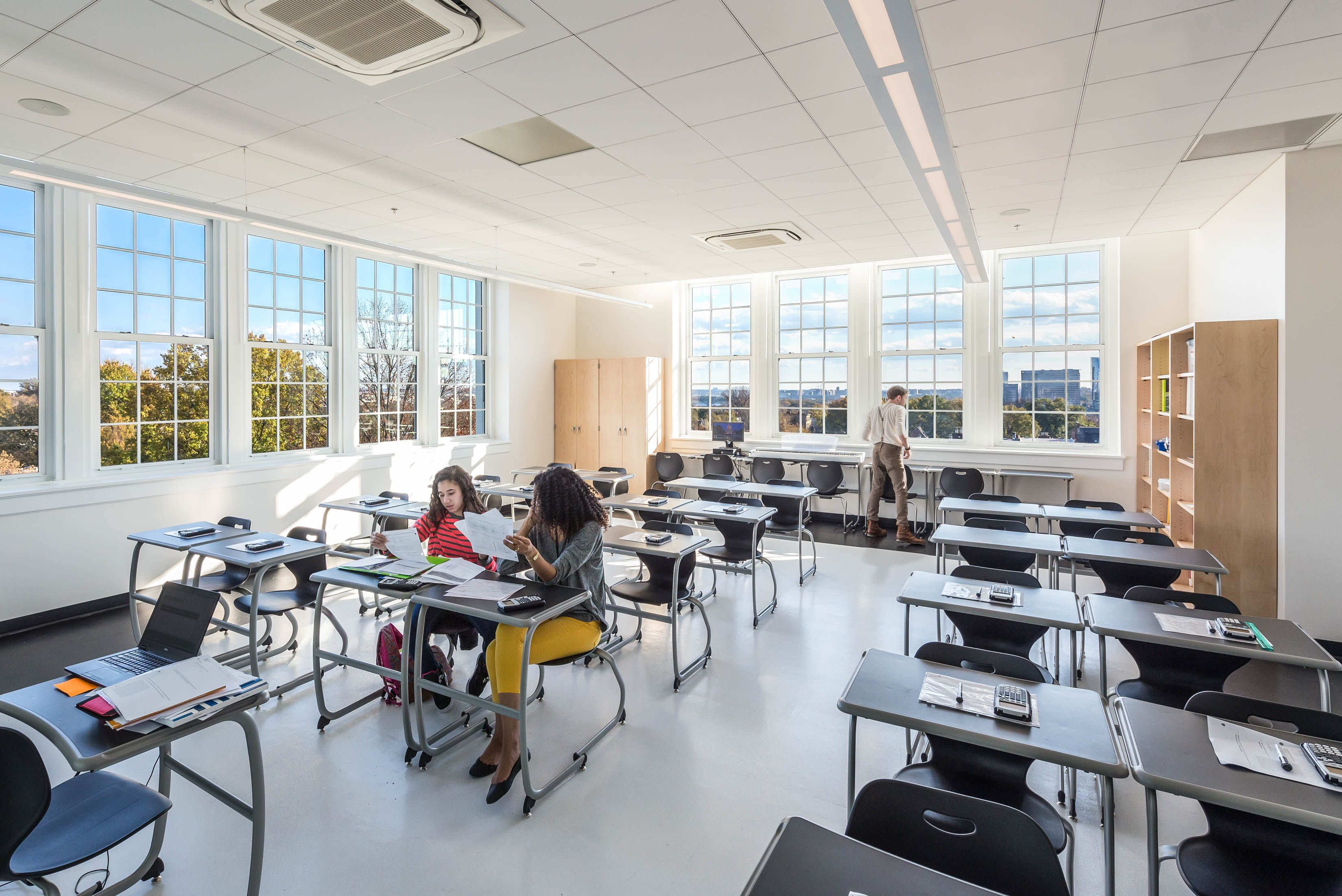 Illuminate Classroom Spaces With Crisp Indoor Lighting For A Better Learning Environment Indoor Design College Architecture Indoor Lighting Fixtures