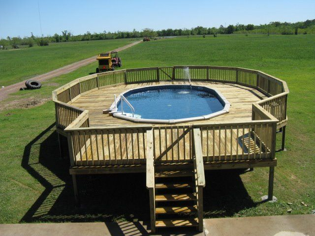 Great pool deck on oval above ground pool from cryer pools and spas pool for Oval swimming pool above ground