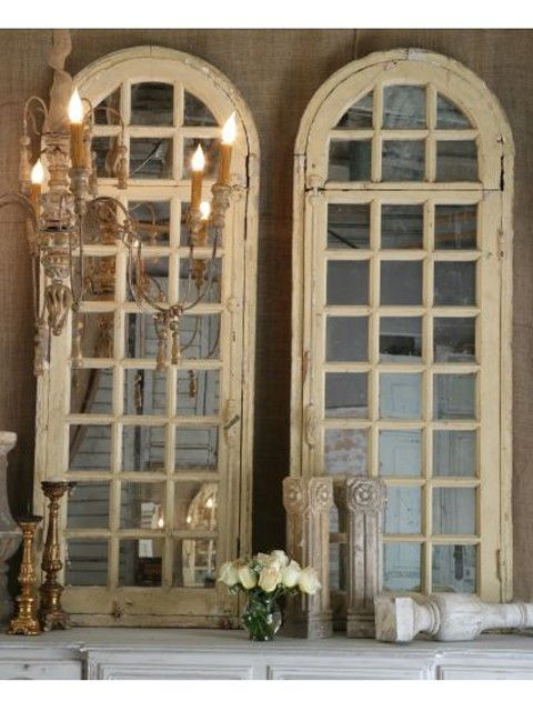 Old arch windows with a mirror behind them. Beautiful!