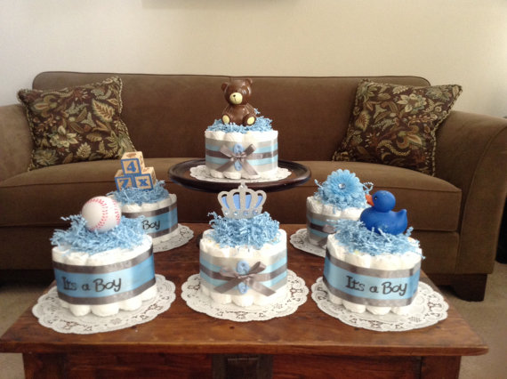 It S A Boy Baby Shower Centerpieces Bundt Diaper Cakes Different Colors And Sizes Available Too Boy Baby Shower Centerpieces Baby Shower Diaper Cake Baby Shower Centerpieces
