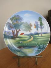 This is a vintage Ucagco Plate (hand-painted & signed) w/original Metal Bamboo Plate Stand. The art has a VERY ME look to it!!