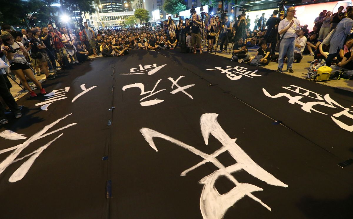 Protestors hold a Black Cloth match to Chater Road from Causeway Bay on July 4, 2014. Photo: David Wong