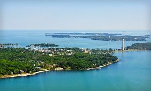 Groupon - 2- or 3-Night Stay for 8 with Golf-Cart Rental and Dining Credit at Island Club in Put-in-Bay, OH  in Put-in-Bay, OH. Groupon deal price: $343