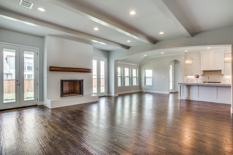 Gray living room cedar beam painted brick fireplace - Beams in living room ...