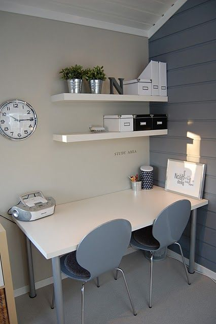 floating shelves for office organization in a modern grey and white room