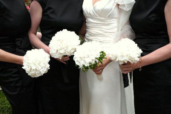 I like the simple white hydrangeas with black bridemsaid dresses ...