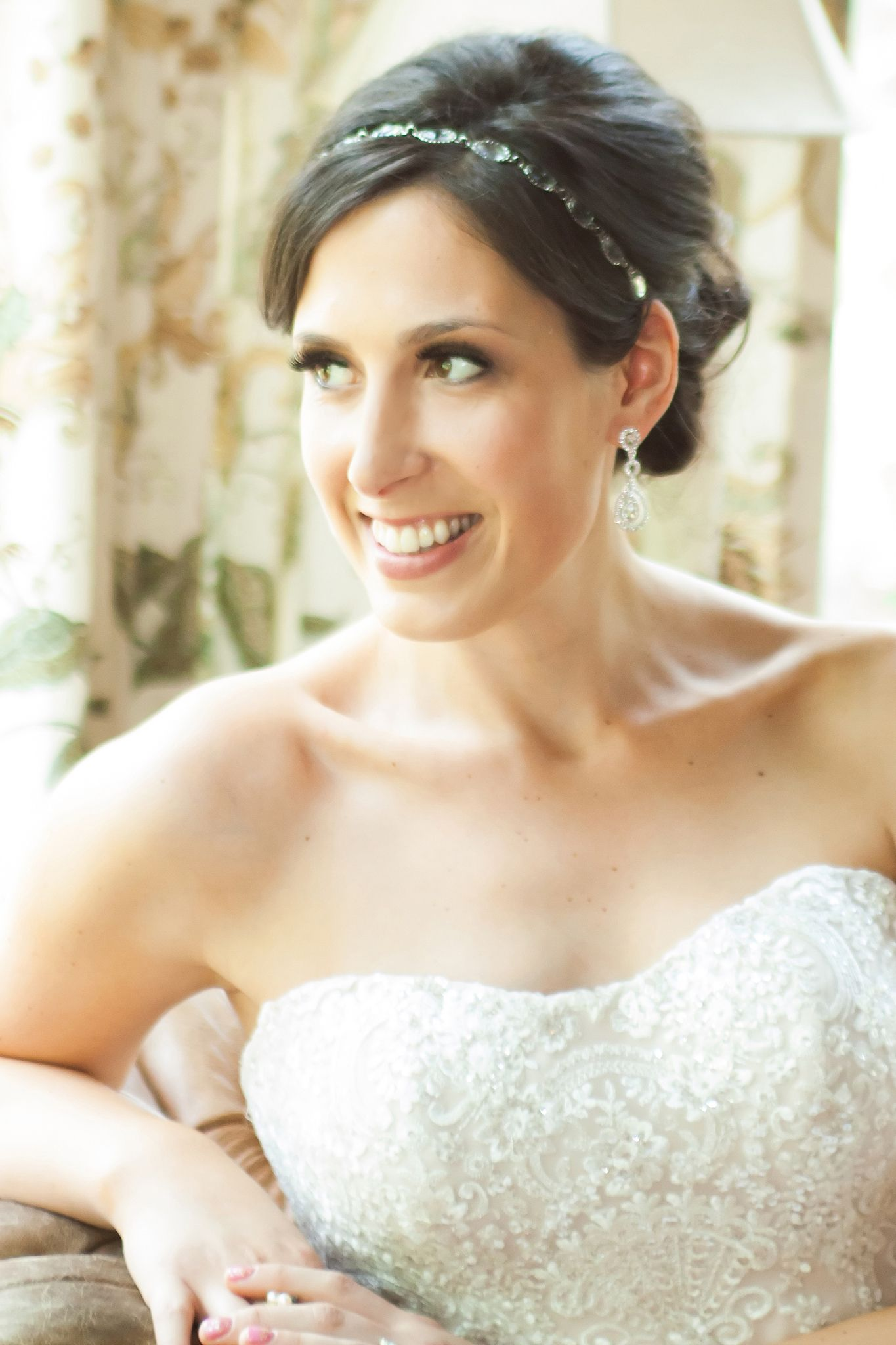 Classic, romantic bridal updo by Classic Hair and Makeup