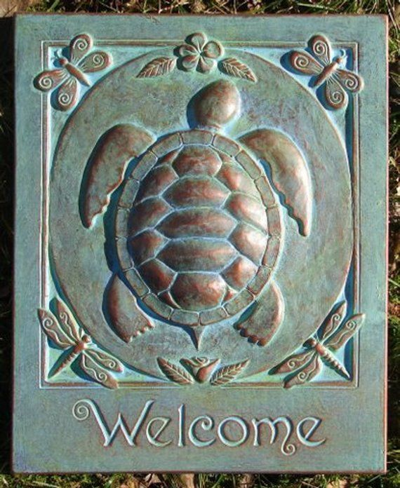 Turtle Welcome Concrete Garden Art Plaque is part of Concrete garden Art - 2 d Materials Concrete, copper wire, and outdoor paint  Hand painted with an outdoor protective paint, so you can hang this outside in any weather and the color will stay  There is a copper wire embedded in the back, easy to hang  This is NOT a store bought mold   This is an original design and handmade by the Harland family  This plaque is the perfect gift for your garden or inside your home  Each item is hand painted, so they will vary slightly in finish