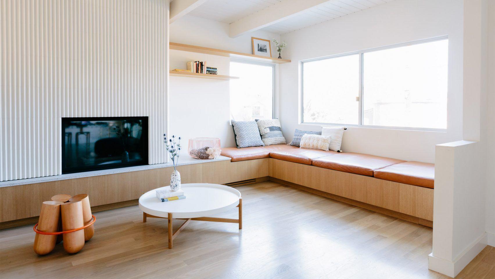 L vormige woonkamer met scandinavische eethoek en mintgroene keuken