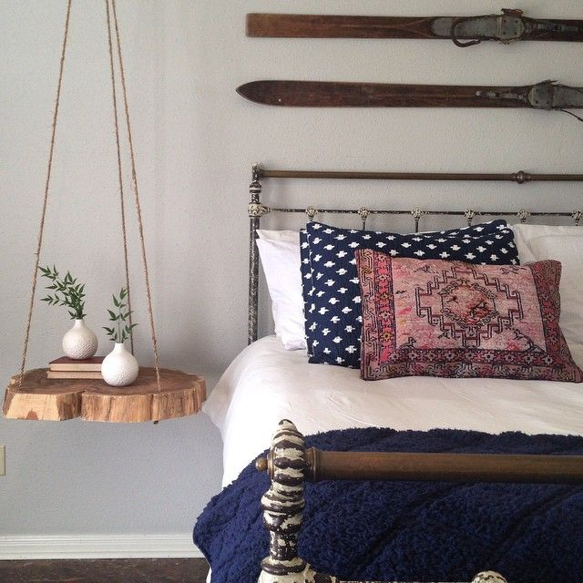 A Wood Stump Hung In The Bedroom Makes The Perfect Bedside Table