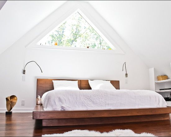 Love the window in this attic master bedroom