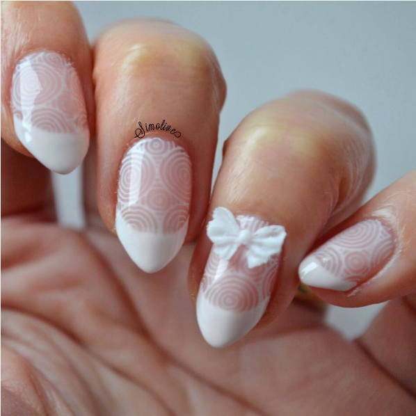 Cute white bow nail design
