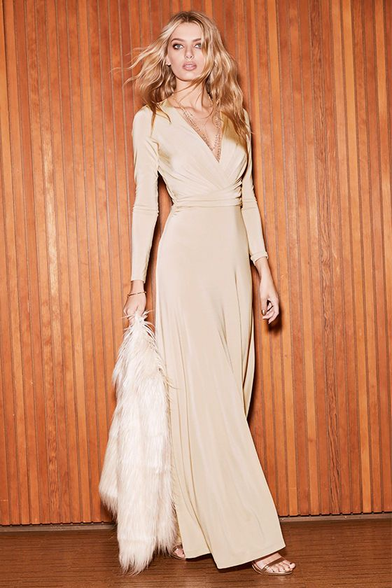 5cacadd7a6eb5 Usher in the seasons with style in the Chic-quinox Beige Long Sleeve Maxi  Dress! Beige jersey knit shapes a surplice bodice framed by long sleeves.