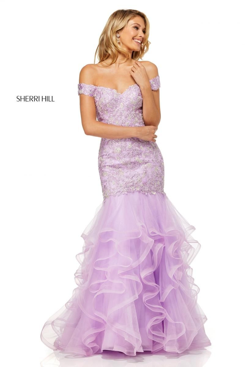 b3c0338f157b Style 52559 from Sherri Hill is an off the shoulder mermaid prom gown with  an embellished bodice and a sheer ruffled skirt.