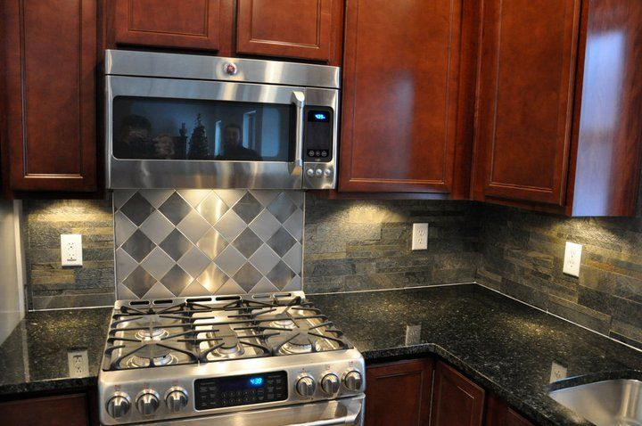 cherry cabinets and ubatuba hehehe granite countertops with stainless steel gas range
