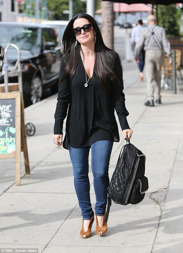 Kyle Richards w  her large quilted Falabella backpack.  edcf4af5f2204