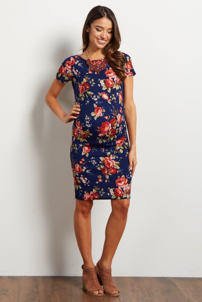 2a31bac319 This maternity dress features a gorgeous floral print you won t find  anywhere else. We love the beautiful mix of hues and short sleeves that  make this piece ...