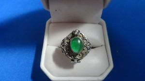 Emerald poison ring.  I have a thing for vintage poison jewelry...so cool!