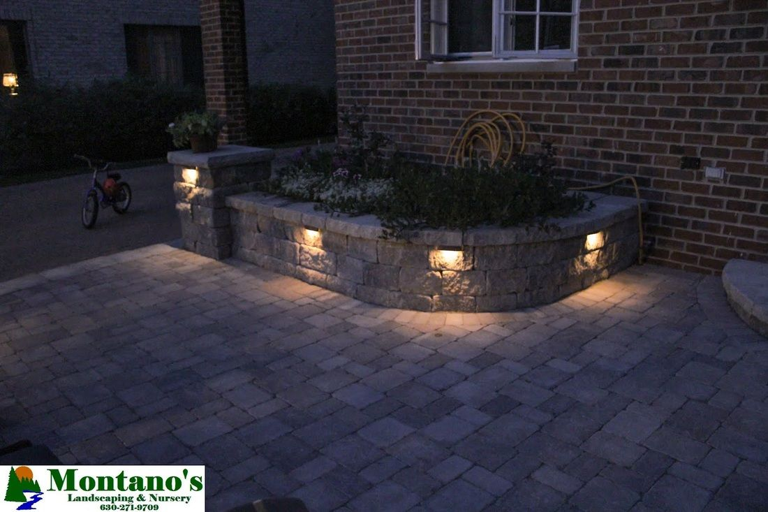 Landscape lighting installed within a retaining that holds a ... on brick raised garden plans, brick backyard ideas, brick raised vegetable garden, brick raised flower garden,