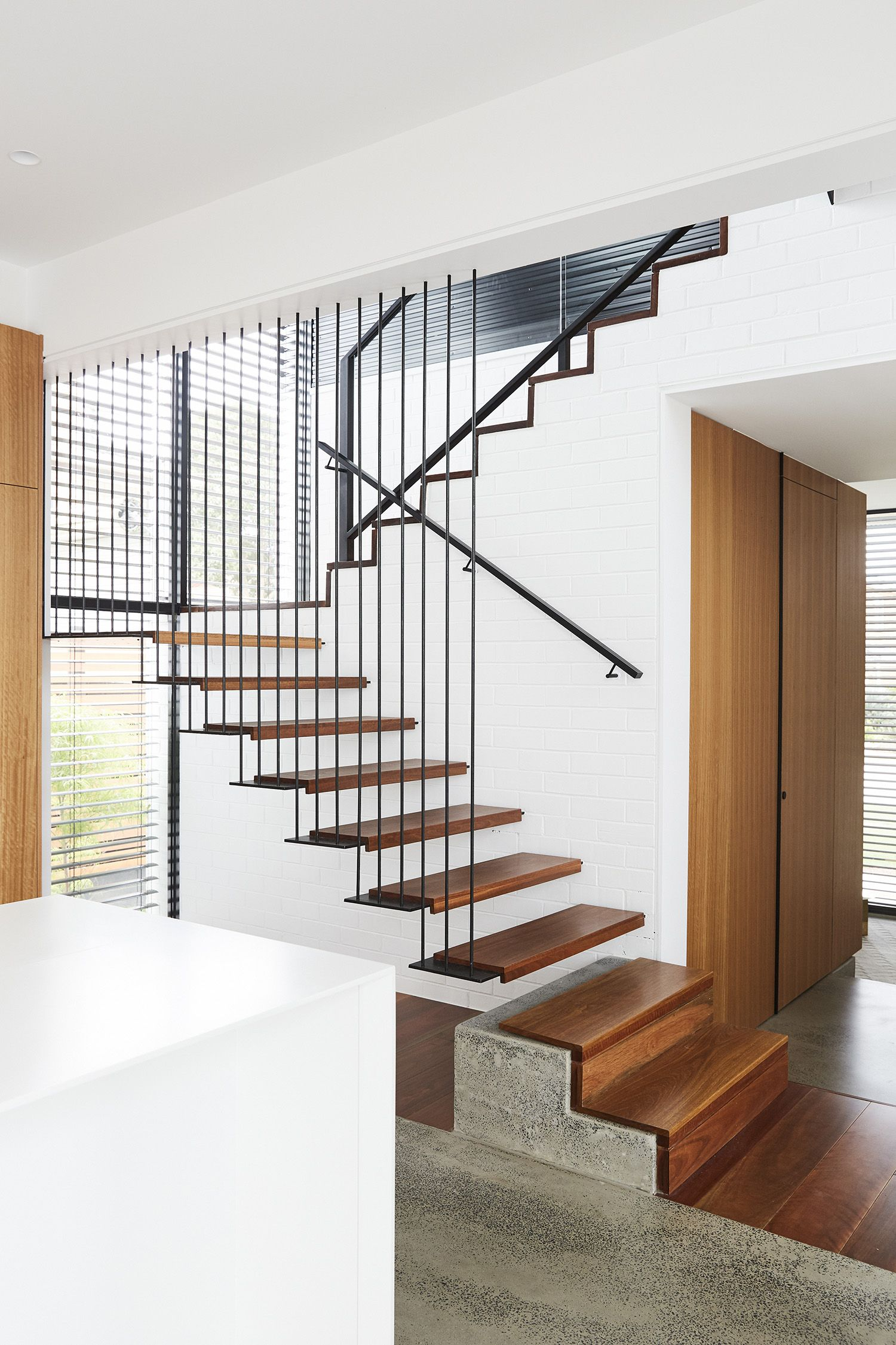 Best Cantilevered Stair Butted Treads Iron Balustrade 400 x 300