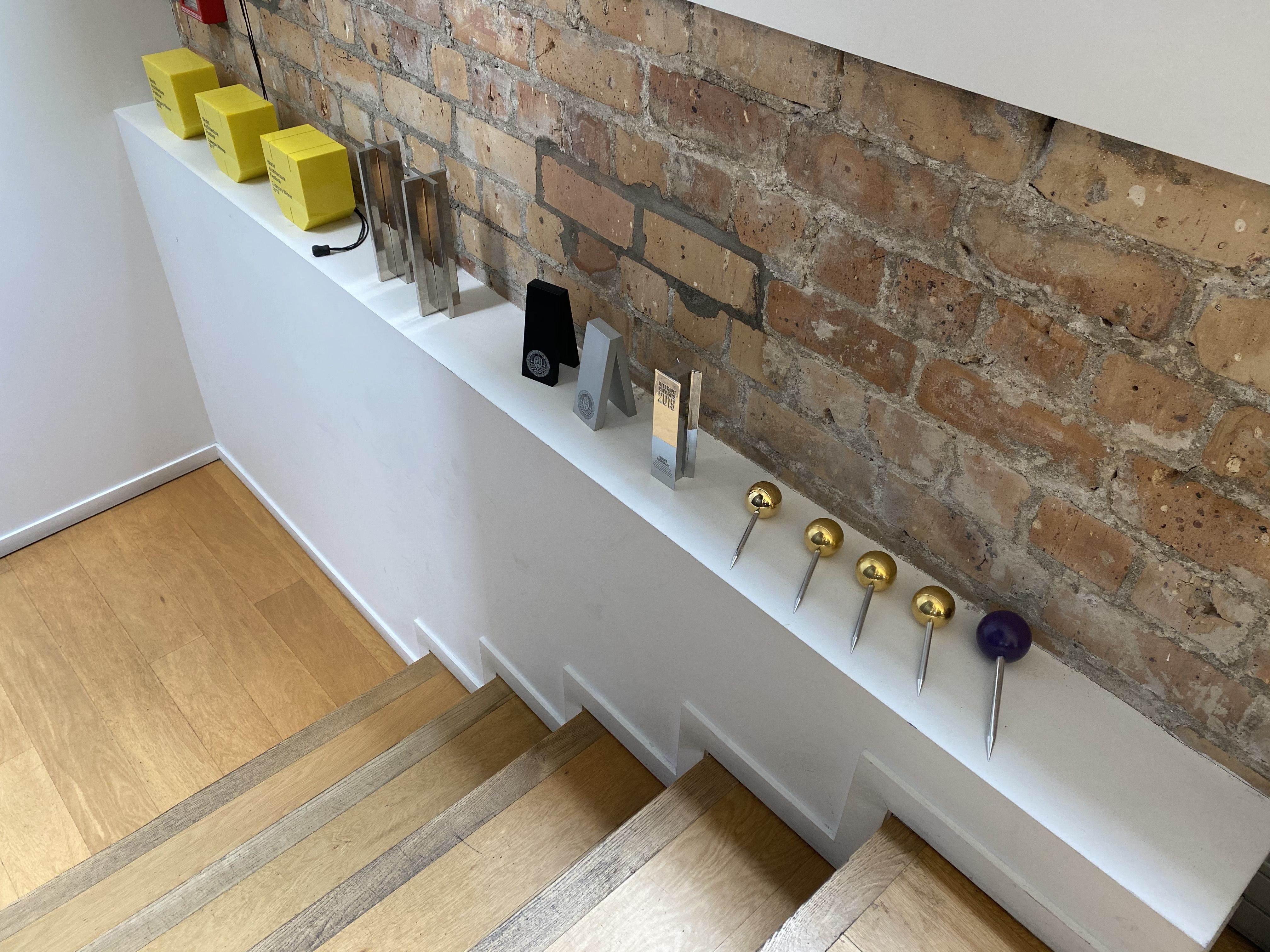 Best design awards purple and gold pins on display in 2020