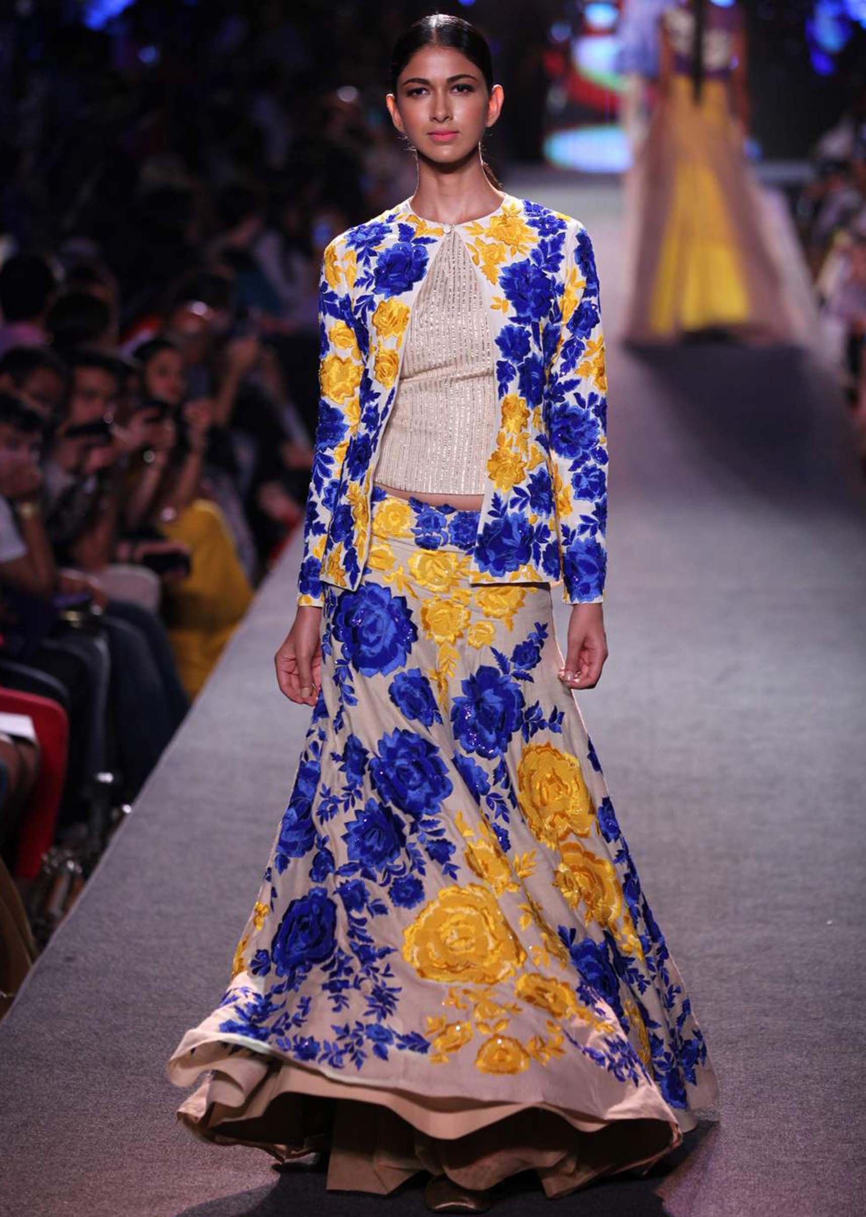 Model walks the ramp in light purple gown adorn in zari embroidery