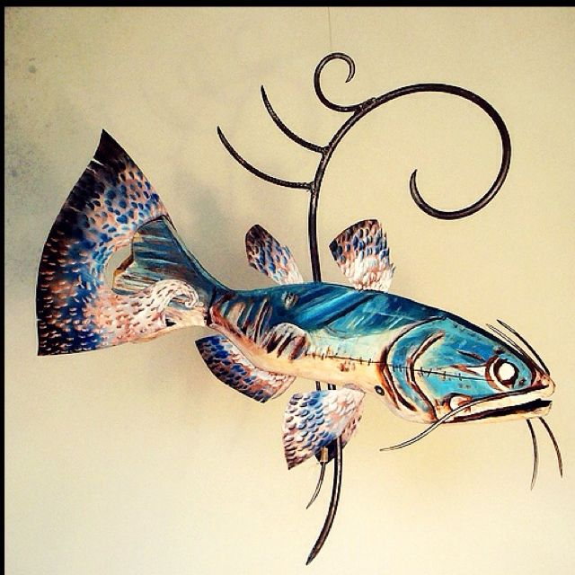 "Fish are the new sexy in Art! Sculpture of fish are perfect for an outdoor (make sure it's protected from the environment) kitchen or ""camp"" as some call their second house ;)      I say hang it for all the world to see.   Various fish and looks available!!!     Artist: Kelly Guidry 