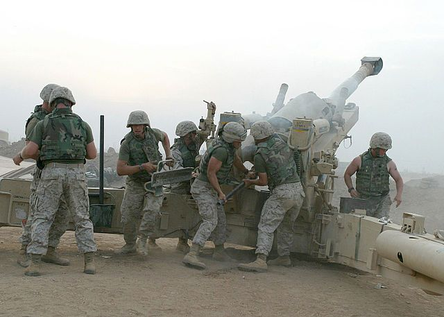 USMC M-198 firing outside of Fallujah, Iraq in 2004