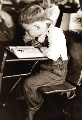 School Boy from 1938.The child looks to be bare footed, which was a common thing during this period, as many people simply could not afford shoes for their children. When I see pictures like this, I wonder what ever happened to the child.