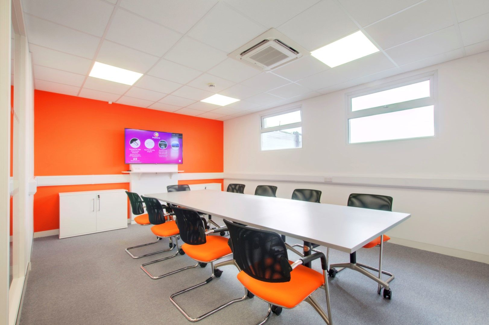 An Office Meeting Boardroom With A Shared Desk And Presentation Screen Meetingroom