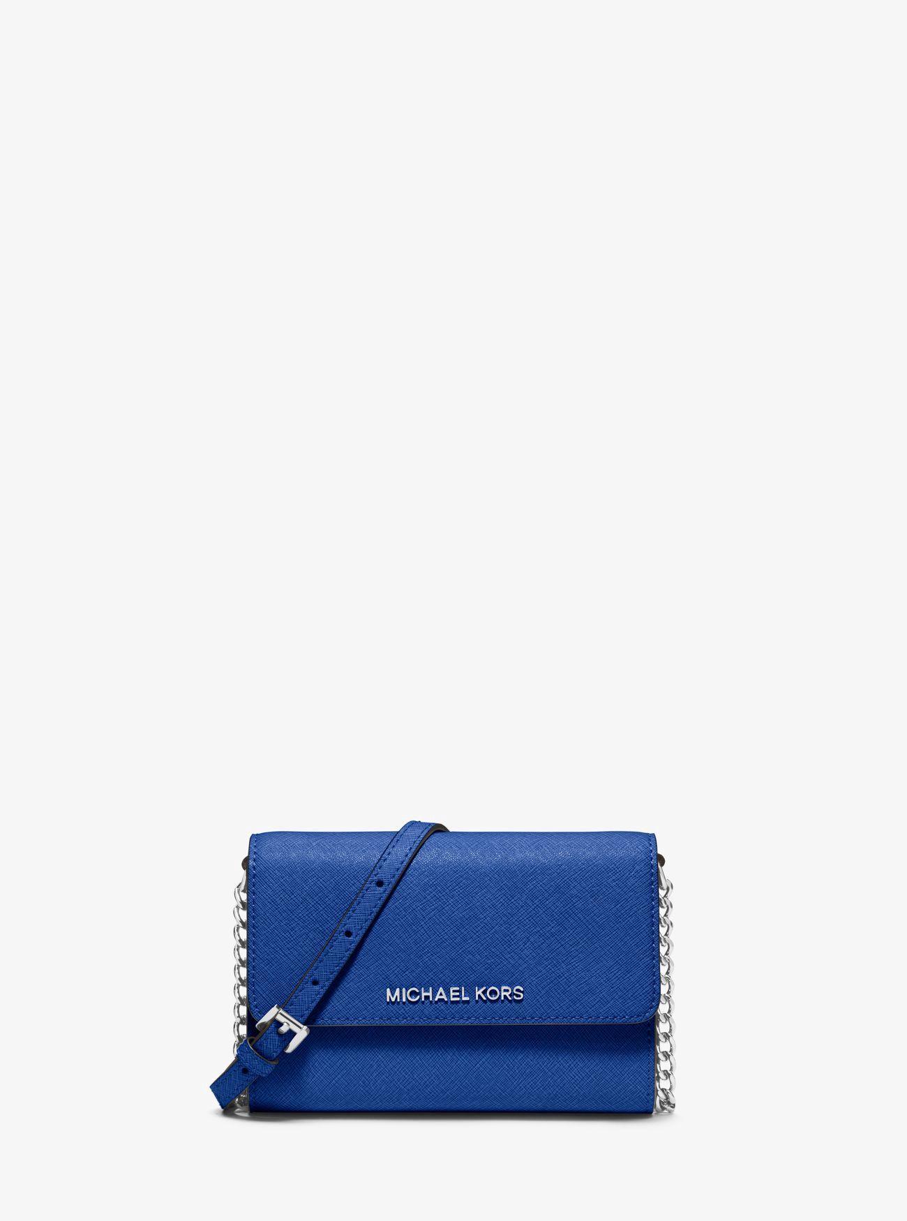 790ec884a7ef MICHAEL KORS Jet Set Travel Saffiano Leather Smartphone Crossbody.  #michaelkors #bags #shoulder bags #leather #polyester #crossbody #lining #