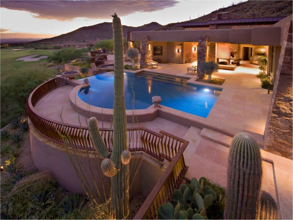 Patio Pools Of Tucson, Inc Built This Beautiful Infinity Pool Which  Complements The Incredible Open Air Living Spaces.
