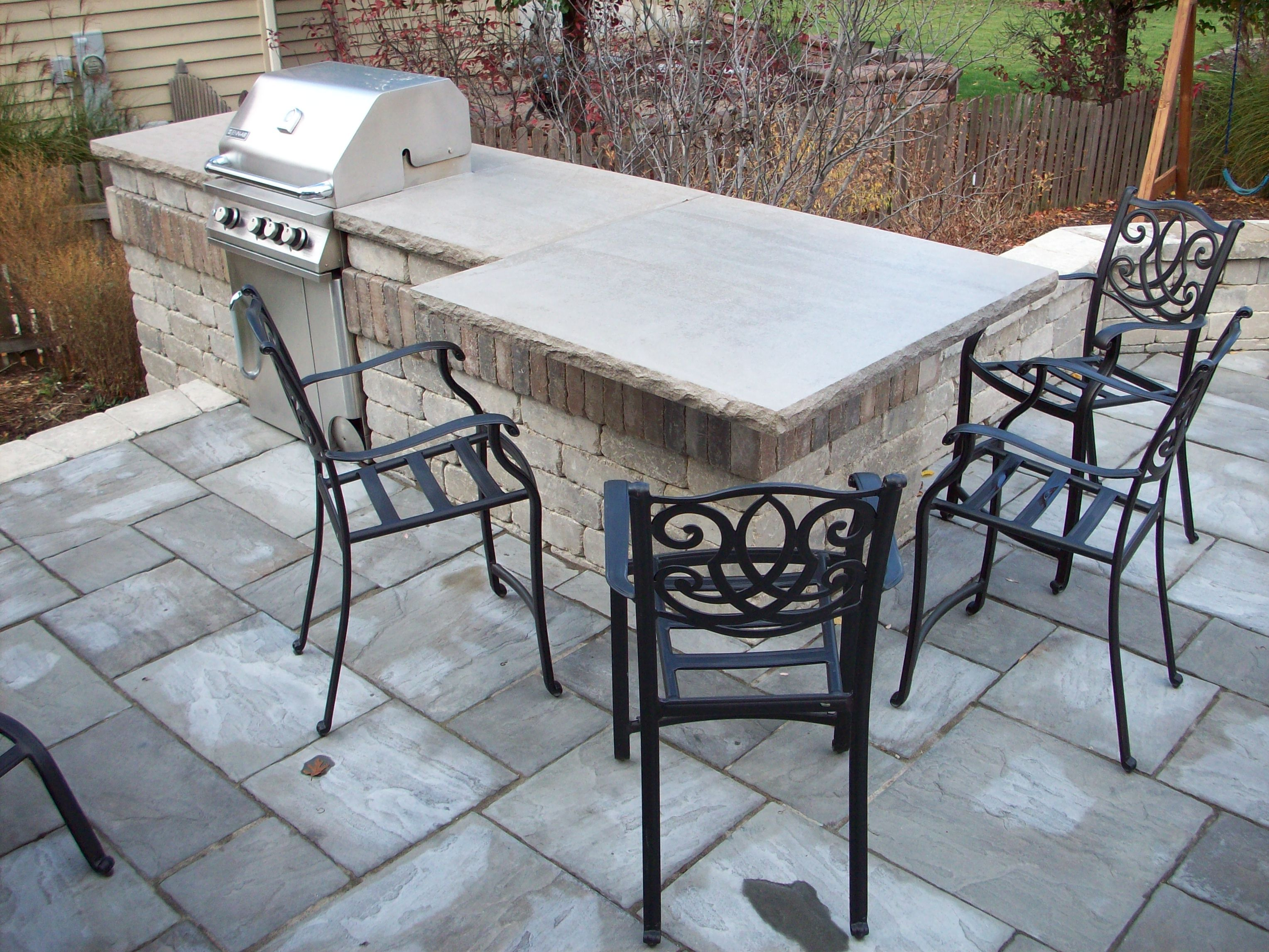 outdoor kitchens - unilock olde quarry bbq, limestone countertop