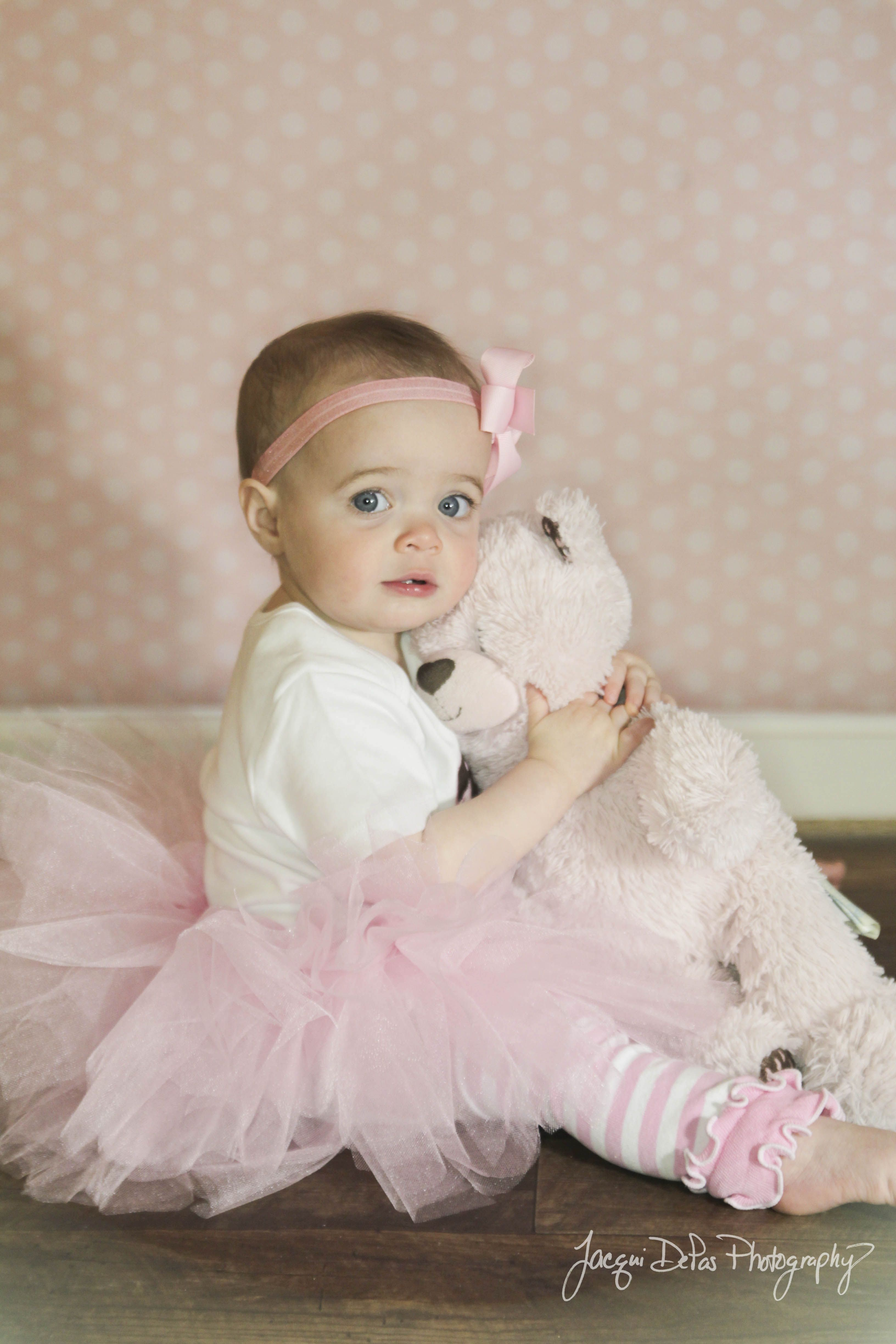 toddler and her bear.  One year shoot
