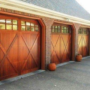 What A Beautiful Door For Fall Decorating A Sense Of History Underlies This Wood Garage Door Garage Door Styles Wooden Garage Doors Residential Garage Doors